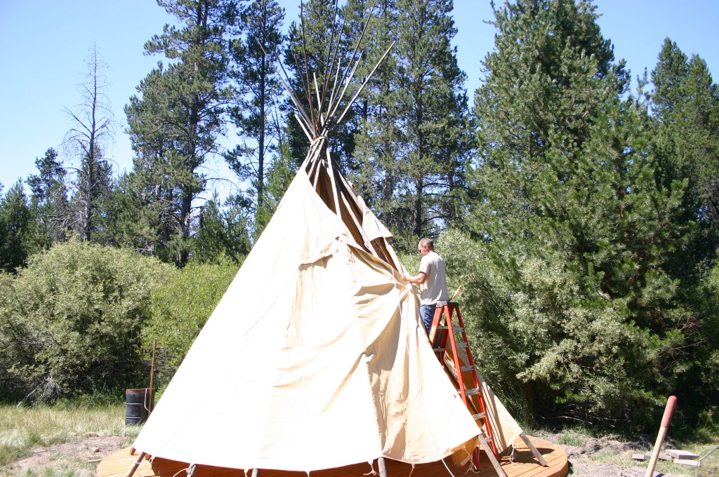 putting canvas on teepee